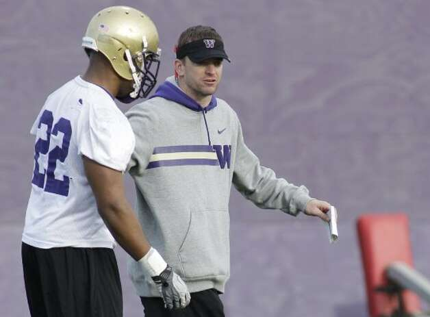 UW's new defensive coordinator Justin Wilcox may love being a Husky, but he's a Duck. (Ted S. Warren / Associated Press)