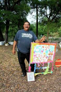 UTSA president Dr. Ricardo Romo captured this image last year of a Cerna whose sign says his family has been camping in Brackenridge Park at Easter for 56 years. Photo: Photo By Dr. Ricardo Romo