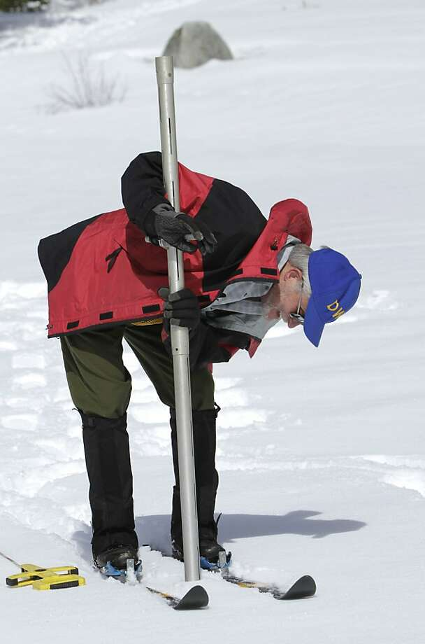 Frank Gehrke, chief of snow surveys for the Department of Water Resources, checks the snow depth during the snow survey at Echo Summit Calif., Monday, April 2, 2012. The survey showed the snow pack to to be 31 inches deep with a water content of 11 inches, which is 39 percent of normal for this site at this time of year. (AP Photo/Rich Pedroncelli) Photo: Rich Pedroncelli, Associated Press