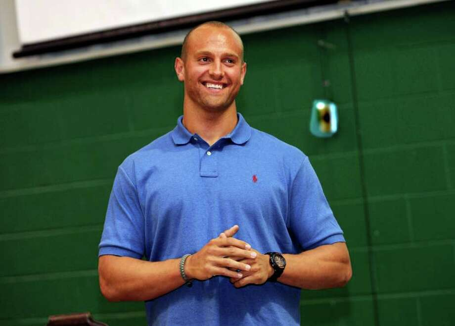 New York Giants linebacker Mark Herzlich Jr. spoke about his fight with cancer and how he became well again at a special school-wide program at Convent of the Sacred Heart Monday, April 1, 2012. Photo: Helen Neafsey / Greenwich Time