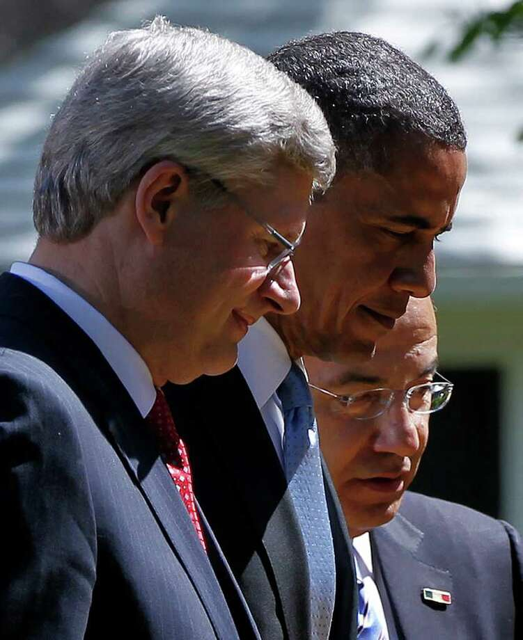 President Barack Obama, Canadian Prime Minister Stephen Harper, left, and Mexican President Felipe Calderon held a 50-minute news conference in the Rose Garden on Monday after closed-door meetings of the leaders earlier in the day. Photo: Pablo Martinez Monsivais / AP