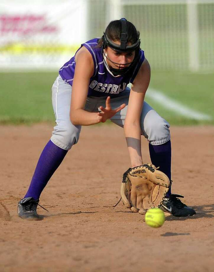 Westhill's Megan D'Alessandro reaches for the ball during Tuesday's class LL semifinal game against Bristol Central at DeLuca Field in Stratford on June 7, 2011. Photo: Lindsay Niegelberg / Connecticut Post
