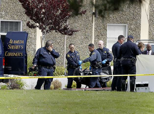 Police and coroners officials lifted one of five victims to a van. Seven people were shot and killed at Oikos University on Edgewater Street in Oakland, Calif. Monday April 2, 2012. Photo: Brant Ward, The Chronicle