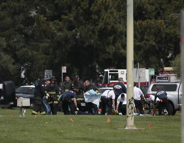 Emergency responders work at the scene of a shooting at Oikos University on Edgewater Road on Monday, April 2, 2012 in Oakland, Calif. Authorities have confirmed that seven people have been killed by a gunman at a Oikos University in Oakland. Photo: Lea Suzuki, The Chronicle
