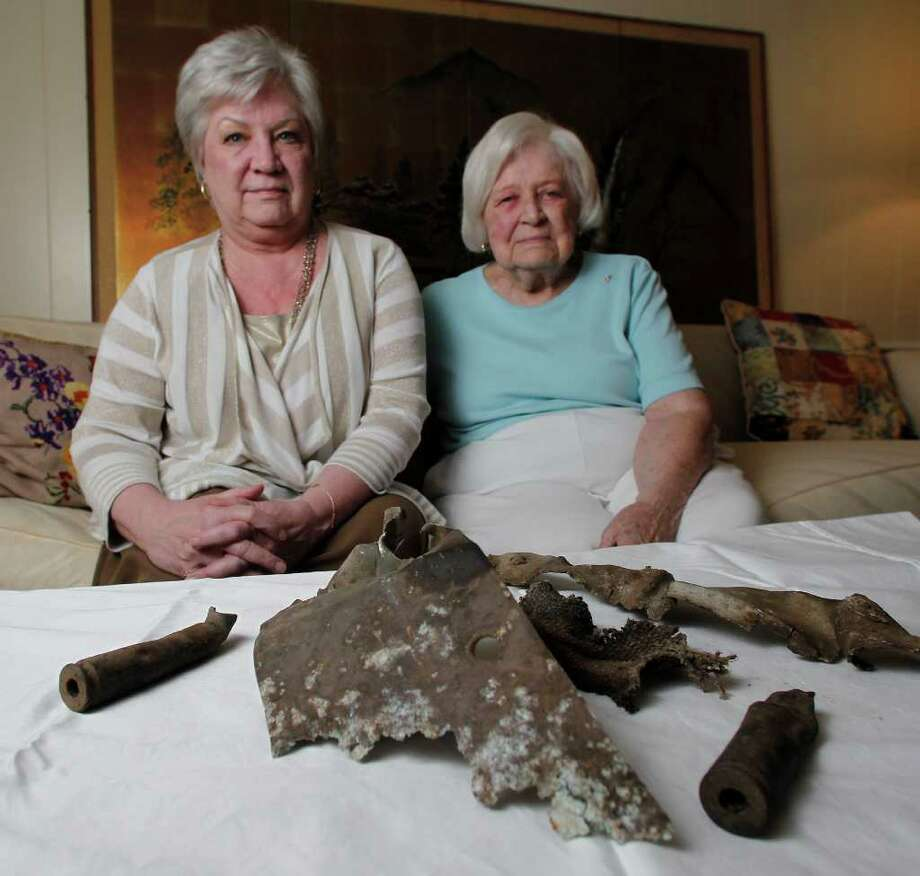Sandra Barker, left, and her mother, Mary Martin, recently received these scraps of the crashed B-17 bomber that Martin's late husband, Kemp, navigated in World War II. Photo: James Nielsen / © 2012 Houston Chronicle
