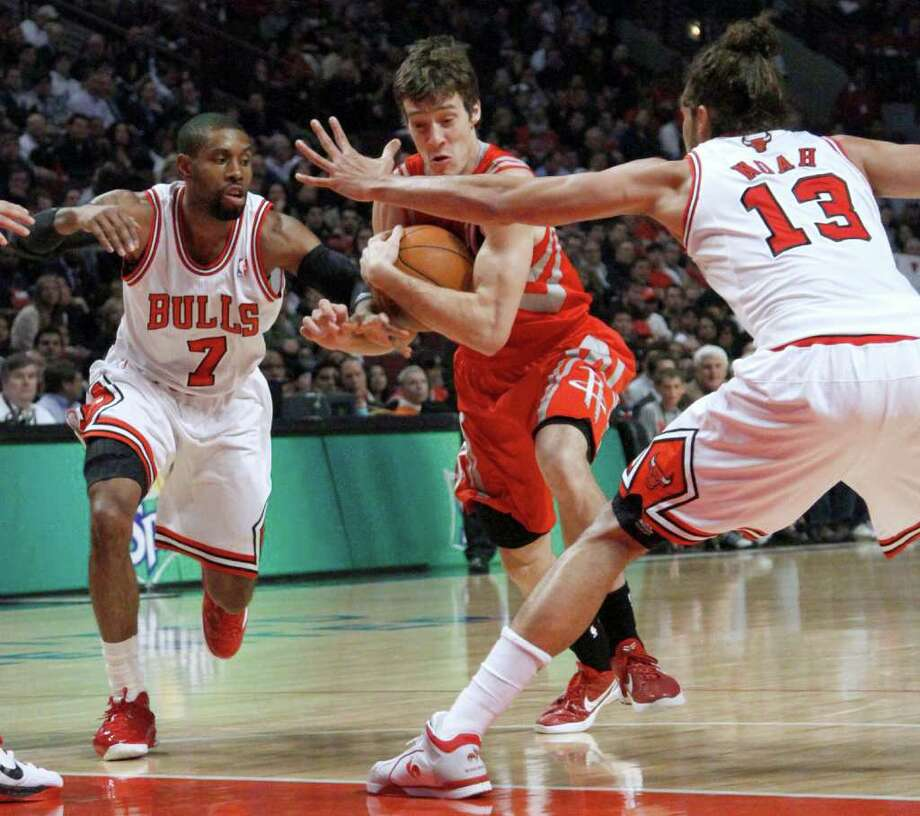 Houston Rockets guard Goran Dragic drives between Chicago Bulls guard C.J. Watson (7) and center Joakim Noah during the first half of an NBA basketball game Monday, April 2, 2012, in Chicago. (AP Photo/Charles Rex Arbogast) Photo: Charles Rex Arbogast, Associated Press / AP