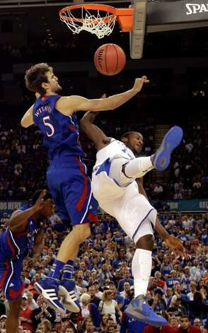 Kentucky forward Michael Kidd-Gilchrist (14) falls to the floor while battling with Kansas center Jeff Withey (5) during the first half of the NCAA Final Four tournament college basketball championship game Monday, April 2, 2012, in New Orleans. (AP Photo/Mark Humphrey) Photo: Mark Humphrey, As