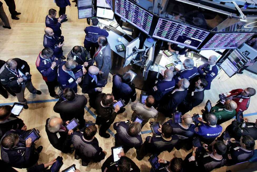 Traders gather at the post that handles Global Payments Inc. on the floor of the New York Stock Exchange, Monday, April 2, 2012, in New York. Visa Inc. has dropped Global Payments, the card processor involved in a massive data breach, from its registry of providers that meet data security standards, but may reinstate it after a new compliance report. (AP Photo/Richard Drew)