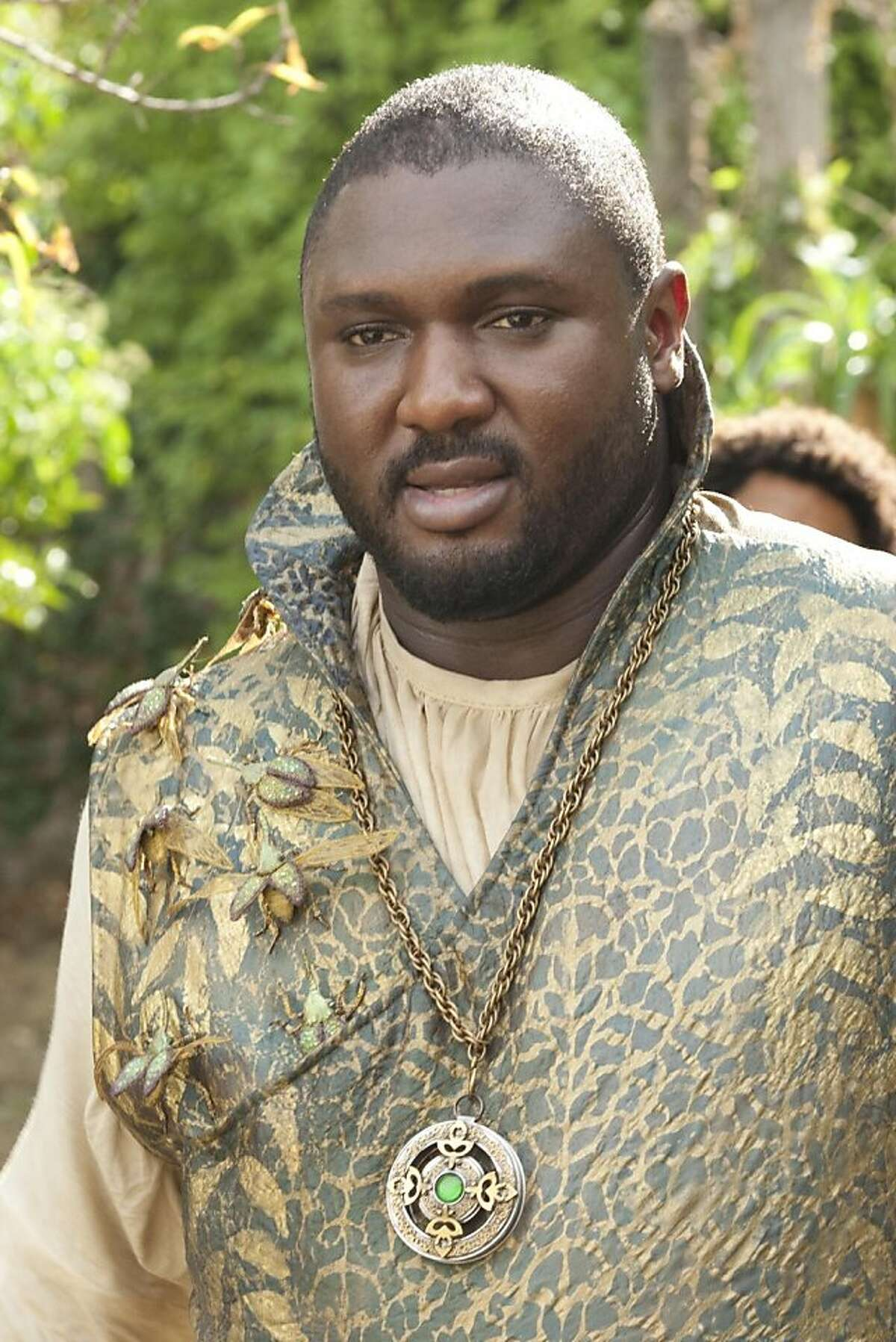 """In this undated image released by HBO, Nonso Anozie portrays Xaro Xhoan Daxos, a member of the Thirteen, a prominent group of traders within Qarth, in a scene from the second season of """"Game of Thrones."""" (AP Photo/HBO, Paul Schiraldi Photography)"""