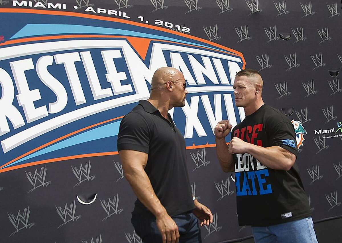 """Dwayne """"The Rock"""" Johnson squares off for a brief moment with opponent John Cena during the WrestleMania 28 press conference Wednesday, March 28, 2012, in Miami Beach, Florida. (C.W. Griffin/Miami Herald/MCT)"""