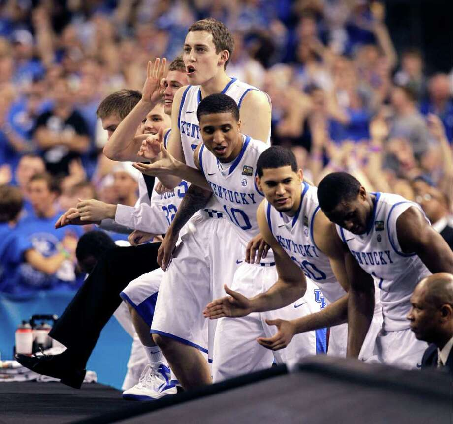 The Kentucky bench cheers during the second half of the NCAA Final Four tournament college basketball championship game against Kansas, Monday, April 2, 2012, in New Orleans. (AP Photo/Mark Humphrey) Photo: Mark Humphrey, Associated Press / AP