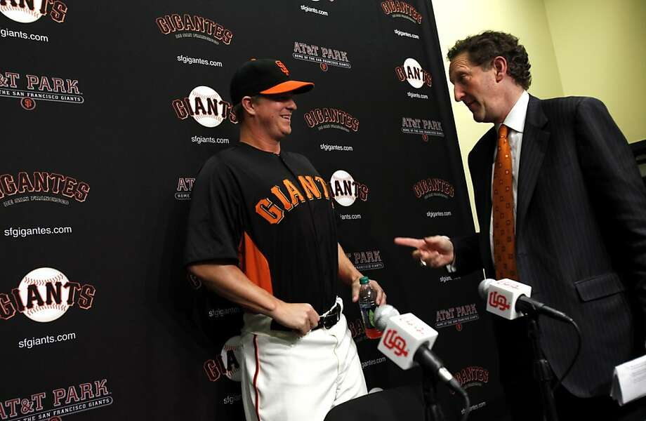 Giant's CEO Larry Baer, right, jokes with Matt Cain after a press conference discussing Cain's signing of five-year extension through the 2017 season with a club/vesting player option for 2018 in San Francisco, Calif., Monday, April 2, 2012. Photo: Sarah Rice, Special To The Chronicle