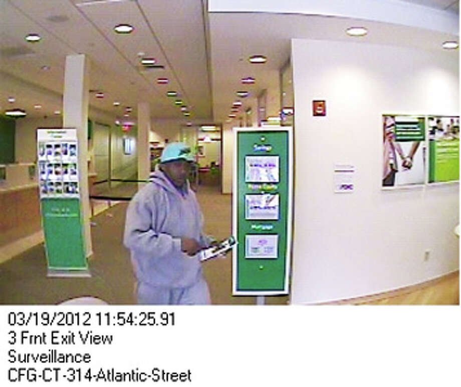 Virginia police have caught a New Haven man and his girlfriend who are wanted for  March bank robberies in Stamford, Conn., and Woodbridge, Conn. Stamford police say Nelson County police have arrested Kevin Bolden, 46, and his girlfriend Moneek Grant, 34, both of New Haven, Conn. Citizens Bank at Broad and Atlantic streets in Stamford was reportedly robbed at noon on Monday, March 19, 2012. The robber is seen on the surveillance camera at Citizens Bank at Broad and Atlantic streets in Stamford. Photo: Contributed Photo / Stamford Advocate Contributed