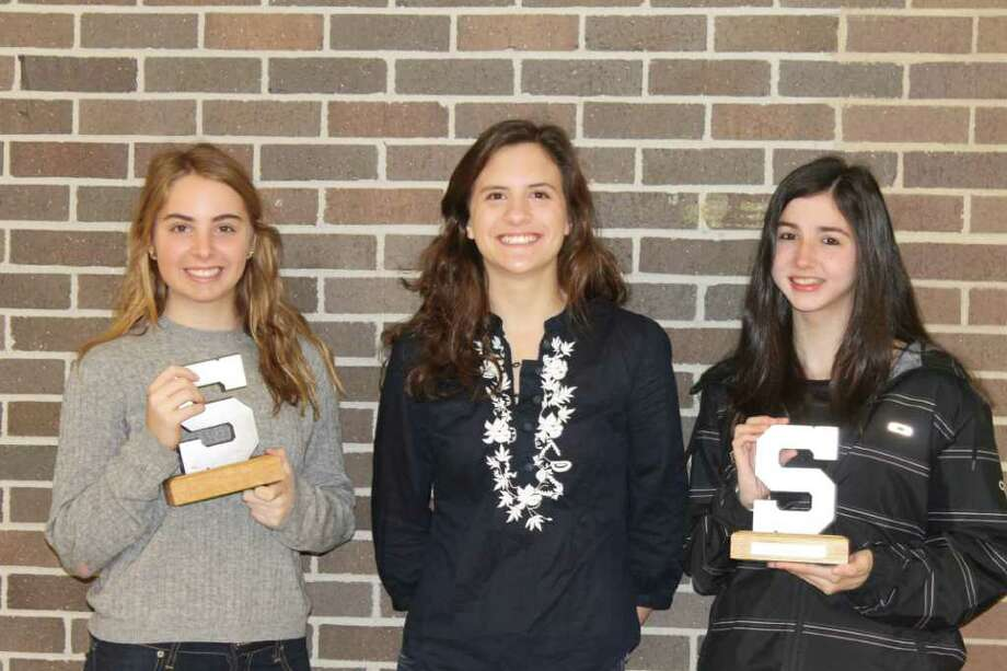 The Staples girls ski team awarded Alex Collins, left, and Jacqueline Chappo, right, as its Block S co-MVPs. Staples selected senior captain Carolkine Howe, center, as its scholar-athlete. Photo: Contributed Photo