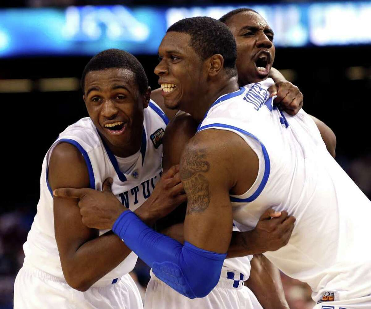 Kentucky guard Doron Lamb,left, forward Terrence Jones (3) and guard Marquis Teague celebrate after the NCAA Final Four tournament college basketball championship game Monday, April 2, 2012, in New Orleans. Kentucky won 67-59