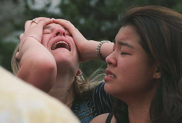 Students react at a triage area near Columbine High School in Littleton Colo., during a shooting rampage by two students on April 20, 1999. Eric Harris and Dylan Klebold killed 12 students and a teacher before taking their own lives in what remains the deadliest school attack in U.S. history. Photo: George Kochaniec, ASSOCIATED PRESS