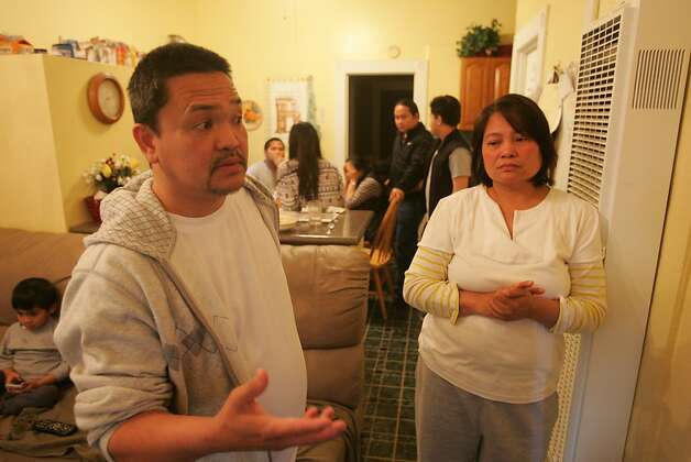 Liberty and Mary Ping talk about their daughter Katleen Ping in the family's East Oakland home. Katleen had started an administrative job at Oikos University about eight months ago. Photo: Mathew Sumner, Special To The Chronicle