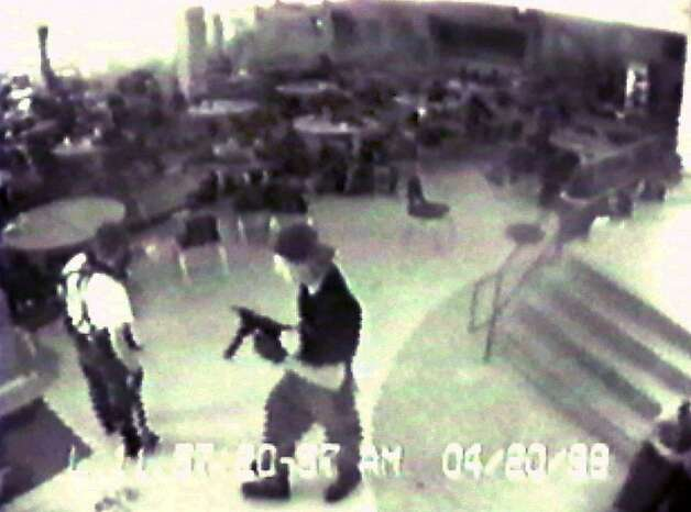 In this April 20, 1999 file photo Eric Harris, left, and Dylan Klebold, carrying a TEC-9 semi-automatic pistol, are seen in a photo made from a security camera image in the cafeteria at Columbine High School, in Littleton, Colo., during their shooting rampage which killed a teacher and 12 students. Photo: Anonymous, ASSOCIATED PRESS