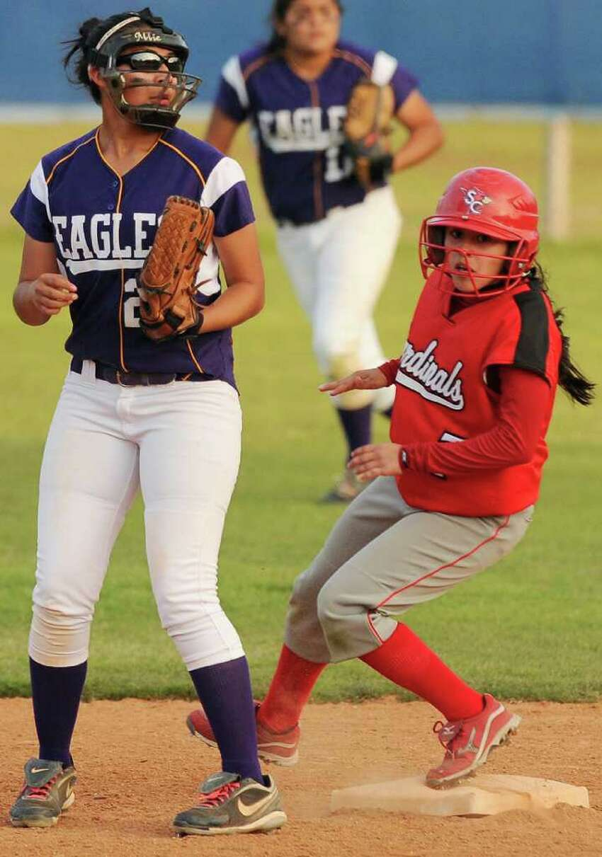Southside's April Rodriguez (right) runs to second behind Brackenridge's Allie Castillo during a District 29-4A softball game, Monday, April 2, 2012, at the SAISD Sports Complex.
