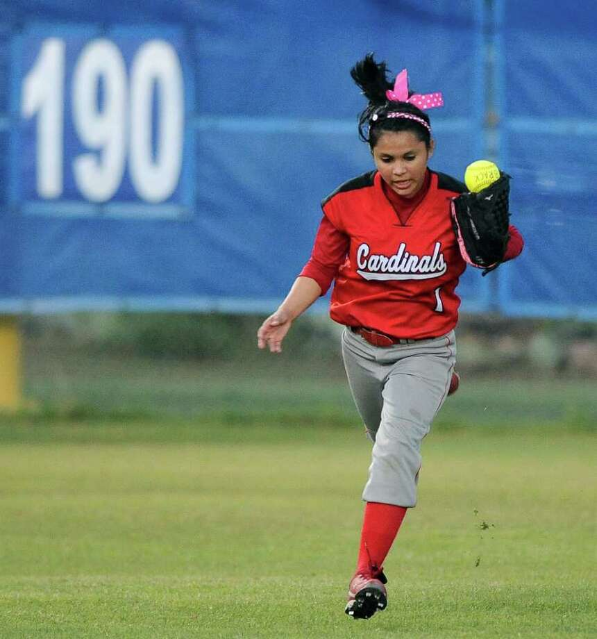 Southside's Kati Coria makes a juggling catch for the out during a District 29-4A softball game against Brackenridge, Monday, April 2, 2012, at the SAISD Sports Complex. Photo: Darren Abate, For The Express-News