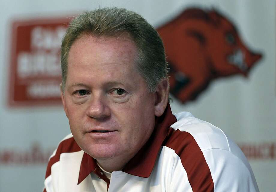 FILE - This Aug. 6, 2011 file photo shows Arkansas college football coach Bobby Petrino speaking to reporters in Fayetteville, Ark. A State Police official says Petrino crashed his motorcycle Sunday night, April 1, 2012, on Arkansas Highway 16 in Madison County near the community of Crosses,  and was taken to a hospital for treatment. (AP Photo/Danny Johnston, File) Photo: Danny Johnston, Associated Press