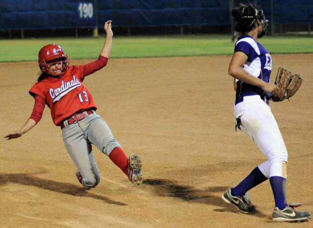 Southside's Lucy Trevino (13) slides into third during a District 29-4A softball game against Brackenridge, Monday, April 2, 2012, at the SAISD Sports Complex. Photo: Darren Abate, For The Express-News