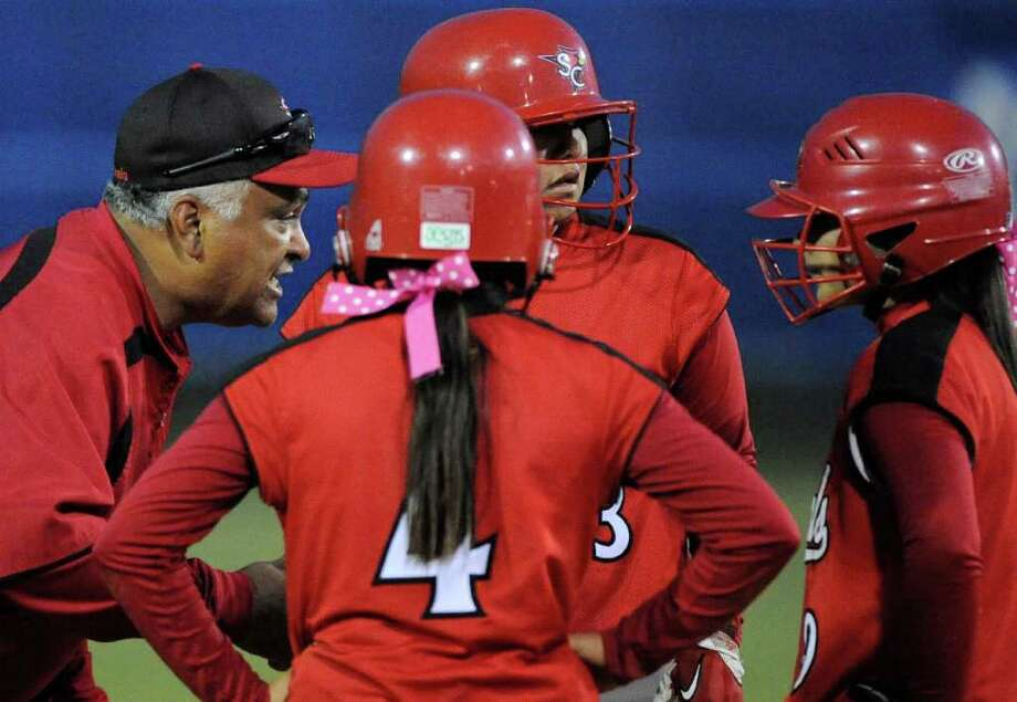 Southside head coach Anthony Alfaro talks to his players during a District 29-4A high school softball game against Brackenridge, Monday, April 2, 2012, at the SAISD Sports Complex. Photo: Darren Abate, For The Express-News