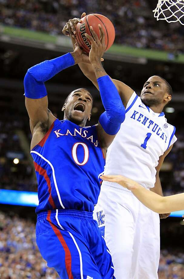 Kansas' Thomas Robinson (0) has his shot blocked by Kentucky's Darius Miller (1) in the NCAA Tournament finals at the Mercedes-Benz Superdome on Monday, April 2, 2012, in New Orleans, Louisiana. (Rich Sugg/Kansas City Star/MCT) Photo: Rich Sugg, McClatchy-Tribune News Service