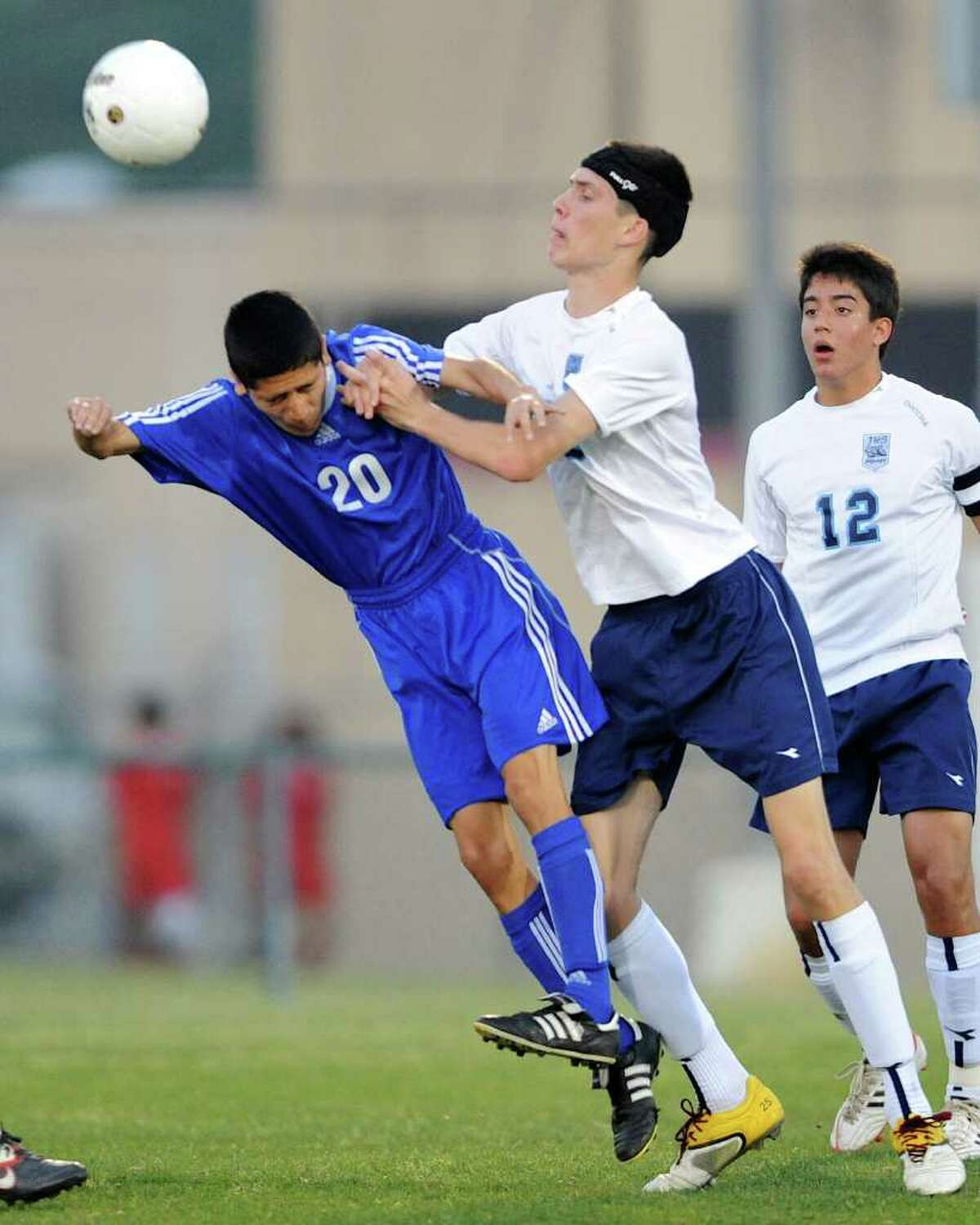 New Braunfels' Joseph Luna (20) and Johnson's Nathan Drouillard (right) collide during a bidistrict playoff match between the Johnson Jaguars and the New Braunfels Unicorns at the Blossom Athletic Center West Soccer Field on Monday, April 2, 2012.