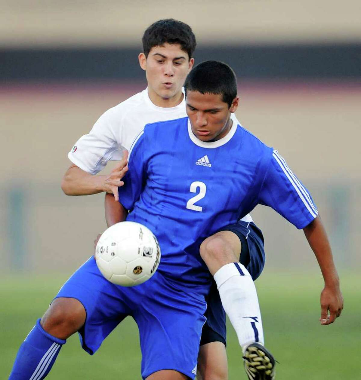 New Braunfels' Christian Cantu (2) and Johnson's Alex Sierra (3) get tangled up as they battle for the ball during a bidistrict playoff match between the Johnson Jaguars and the New Braunfels Unicorns at the Blossom Athletic Center West Soccer Field on Monday, April 2, 2012.