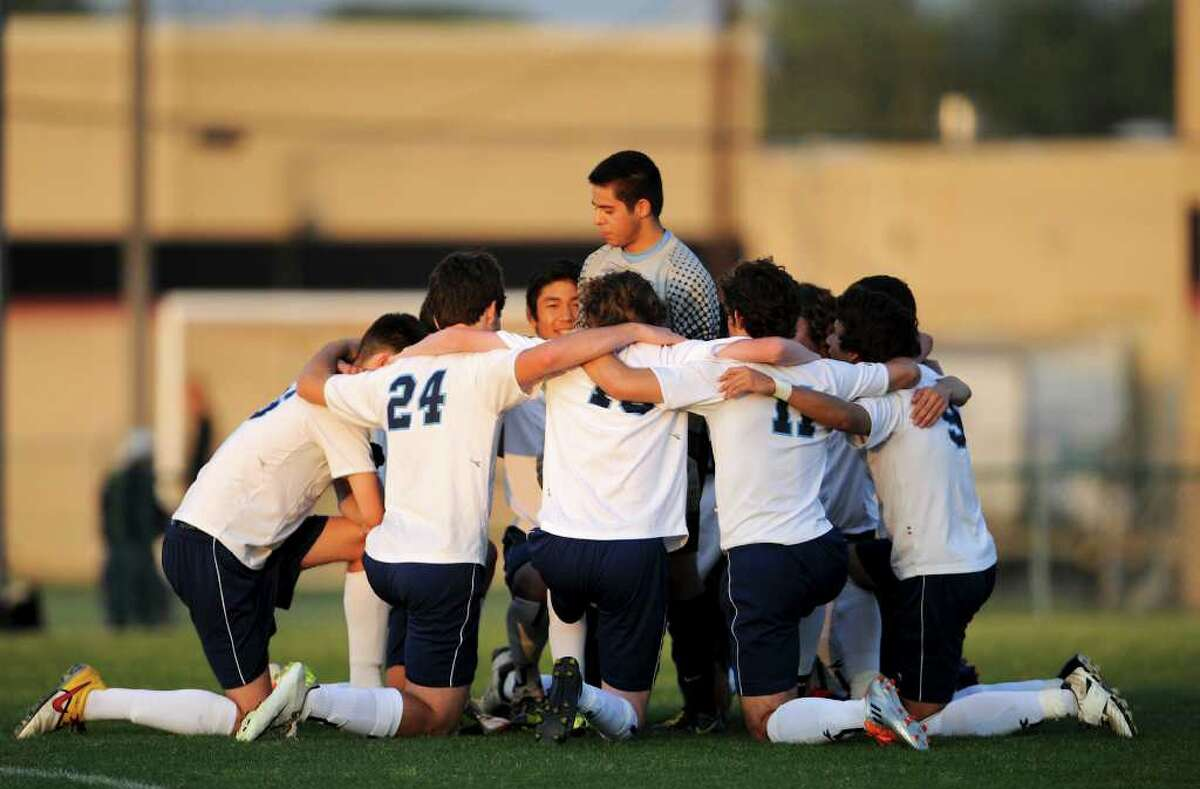 Johnson keeper Rudy Apodaca talks to his team before their bidistrict playoff match between the Johnson Jaguars and the New Braunfels Unicorns at the Blossom Athletic Center West Soccer Field on Monday, April 2, 2012.