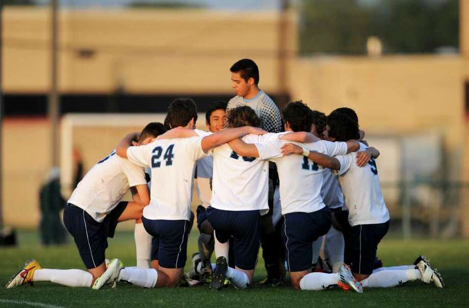 Johnson keeper Rudy Apodaca talks to his team before their bidistrict playoff match between the Johnson Jaguars and the New Braunfels Unicorns at the Blossom Athletic Center West Soccer Field on Monday, April 2, 2012. Photo: John Albright, For The Express-News