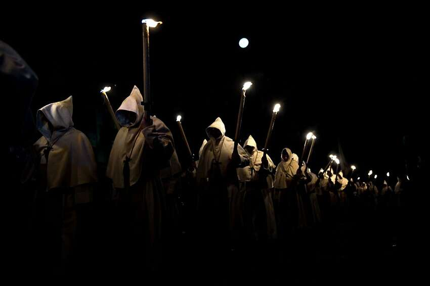 Penitents from Cristo de la Buena Muerte brotherhood participate in a procession in Zamora, Spain, Tuesday, April 3, 2012. Hundreds of processions take place throughout Spain during the Easter Holy Week. (AP Photo/Daniel Ochoa de Olza)