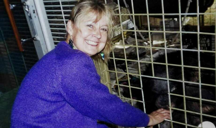 Charla Nash in a 2007 photo next to the cage with the chimpanzee Travis. Travis mauled Nash in February 2009 leaving her without any hands or eyes. Nash had a full face transplant in May at Brigham and Women's Hospital in Boston. Photo: Contributed Photo, ST / Stamford Advocate Contributed