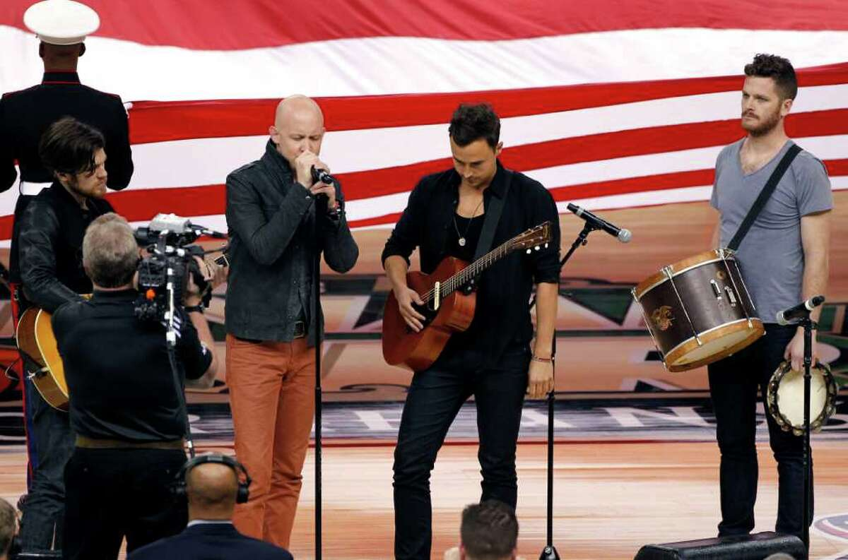 Members of the band 'The Fray' perform the National Anthem before the NCAA Final Four tournament college basketball championship game Monday, April 2, 2012, in New Orleans. (AP Photo/Bill Haber)