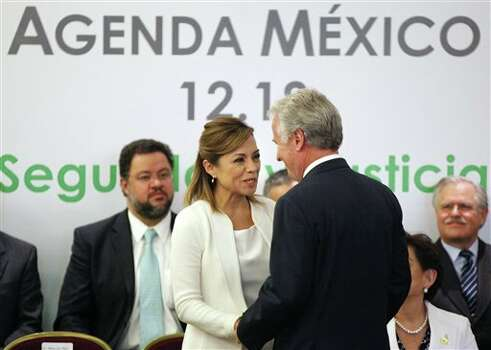 Josefina Vazquez Mota, presidential candidate for the now-governing National Action Party, PAN, center left, chats with Mexican businessman Alejandro Marti, during an event organized by Civil Society Mexico SOS to deliver a document about justice and security, in Mexico City, Monday, April 2, 2012. The four candidates for Mexico's presidency officially launched their campaigns for the July 1 election on Friday, all of them promising change. (AP Photo/Alexandre Meneghini) Photo: Alexandre Meneghini, Associated Press / AP