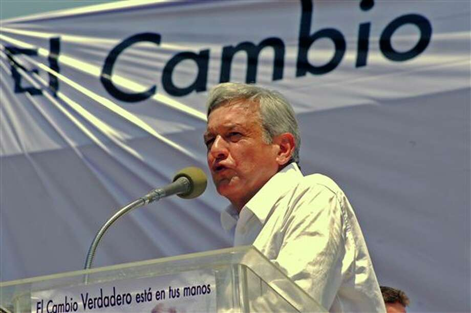 "Presidential candidate Andres Manuel Lopez Obrador, of the Democratic Revolution Party (PRD), speaks during his official campaign kickoff in Macuspana, Mexico, Friday March 30, 2012. The four candidates for Mexico's presidency officially launched their campaigns for the July 1 election on Friday, all of them promising change. The sign at top reads in Spanish ""Change"" and below reads ""Real change is in your hands.""  (AP Photo/America Rocio) Photo: America Rocio, Associated Press / AP"
