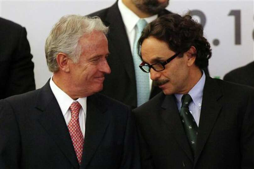 Gabriel Quadri, the presidential candidate for the New Alliance Party (PANAL), right, and Mexican bu