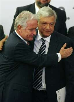 Presidential candidate Andres Manuel Lopez Obrador, of the Democratic Revolution Party (PRD), right, greets Mexican businessman Alejandro Marti, during an event organized by Civil Society Mexico SOS to deliver a document about justice and security, in Mexico City, Monday, April 2, 2012. The four candidates for Mexico's presidency officially launched their campaigns for the July 1 election on Friday, all of them promising change. (AP Photo/Alexandre Meneghini) Photo: Alexandre Meneghini, Associated Press / AP