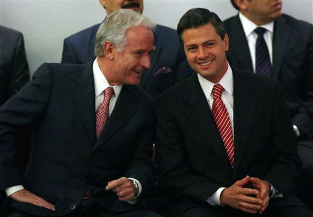 Enrique Pena Nieto, presidential candidate for the Institutional  Revolutionary Party, PRI, right, listens to Mexican businessman Alejandro Marti, left, during an event hosted by the non-governmental organization Mexico SOS, that advocates security and justice, in Mexico City, Monday April 2, 2012. The four candidates for Mexico's presidency officially launched their campaigns for the July 1 election on Friday, all of them promising change. (AP Photo/Alexandre Meneghini) Photo: Alexandre Meneghini, Associated Press / AP