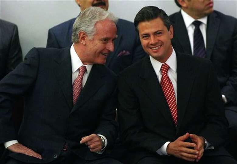 Enrique Pena Nieto, presidential candidate for the Institutional  Revolutionary Party, PRI, right, l