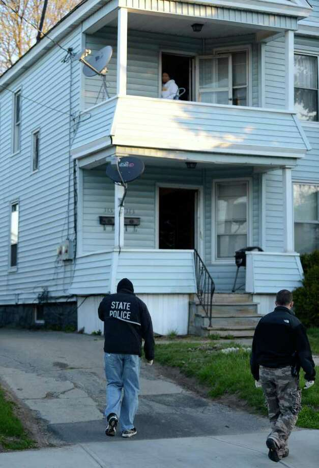 New York State Police investigators early Tuesday morning raided 363-365 Altamont Ave. in Schenectady. (Skip Dickstein / Times Union) Photo: SKIP DICKSTEIN / 00017065A