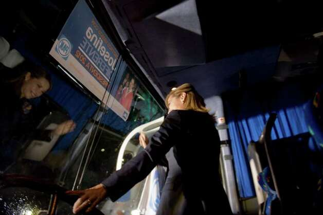Mexican presidential candidate Josefina Vazquez Mota waves from her bus during the opening of her campaign for the July 1 presidential elections in Mexico City on March 30, 2012.  Mota, a 51-year-old economist and former minister, is Mexico's ruling conservative party candidate for presidential elections becoming the first female to stand for president from one of the three main parties.  AFP PHOTO/Alfredo Estrella Photo: ALFREDO ESTRELLA, Getty Images / 2012 AFP