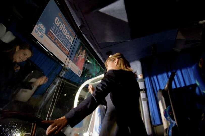 Mexican presidential candidate Josefina Vazquez Mota waves from her bus during the opening of her ca