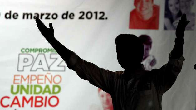 Mexican presidential candidate Enrique Pena Nieto from the Institutional Revolutionary Party (PRI) waves to supporters, during the start of his presidential campaign at Guadalajara square esplanade, in Guadalajara, state of Jalisco, early on March 30, 2012. Mexico will hold presidential elections next July 1, 2012.   AFP PHOTO/Hector Guerrero Photo: HECTOR GUERRERO, Getty Images / 2012 AFP