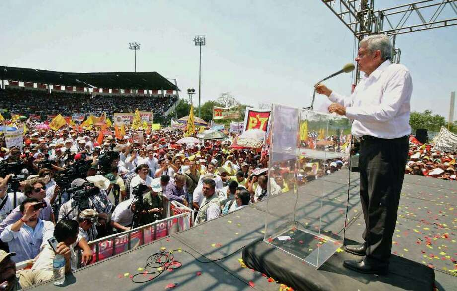 Mexican presidential candidate of the leftist coalition Progressive Movement of Mexico, Andres Manuel Lopez Obrador (C) addresses supporters during a first massive event on the launching of his electoral campaign for the July 1 presidential elections, in Macuspana, Tabasco State, Mexico on March 30, 2012.  AFP PHOTO/Gilberto Villasana Photo: GILBERTO VILLASANA, Getty Images / 2012 AFP