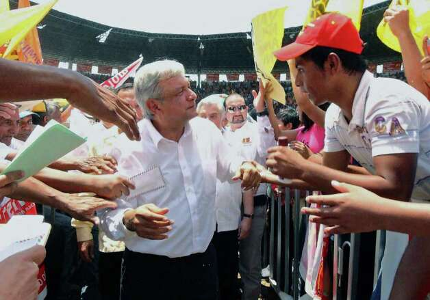 Mexican presidential candidate of the leftist coalition Progressive Movement of Mexico, Andres Manuel Lopez Obrador (C) greets supporters during a first massive event on the launching of his electoral campaign for the July 1 presidential elections, in Macuspana, Tabasco State, Mexico on March 30, 2012.  AFP PHOTO/Gilberto Villasana Photo: GILBERTO VILLASANA, Getty Images / 2012 AFP