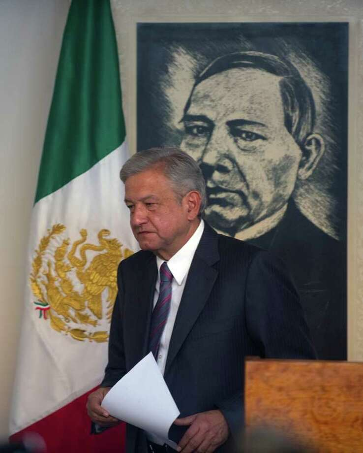 Mexican presidential candidate of the leftist coalition Progressive Movement of Mexico, Andres Manuel Lopez Obrador, leaves a press conference before the launching of his electoral campaign for the July 1 presidential elections, in Mexico City on March 30, 2012.    AFP PHOTO/Yuri CORTEZ Photo: YURI CORTEZ, Getty Images / 2012 AFP