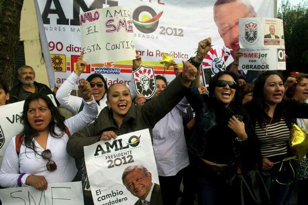 Supporters of Mexican presidential candidate of the leftist coalition Progressive Movement of Mexico, Andres Manuel Lopez Obrador, chher during the launching of his electoral campaign for the July 1 presidential elections, in Mexico City on March 30, 2012.    AFP PHOTO/Yuri CORTEZ Photo: YURI CORTEZ, Getty Images / 2012 AFP