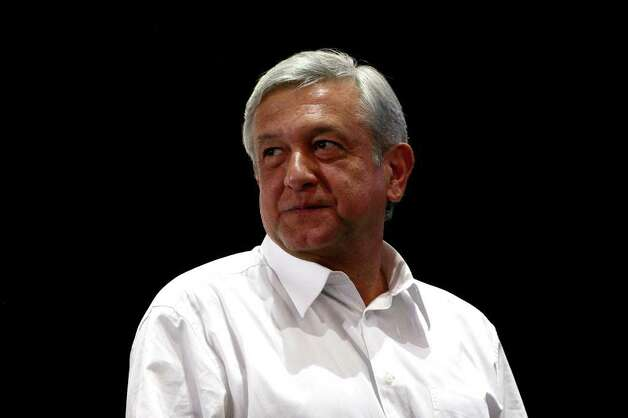 Mexican presidential candidate of the leftist coalition Progressive Movement of Mexico, Andres Manuel Lopez Obrador, is pictured upon arrival at a massive event of his electoral campaign, in Tlajomulco, state of Jalisco, on March 31, 2012. Mexico will hold presidential elections next July 1, 2012. AFP PHOTO/Hector Guerrero Photo: HECTOR GUERRERO, Getty Images / 2012 AFP